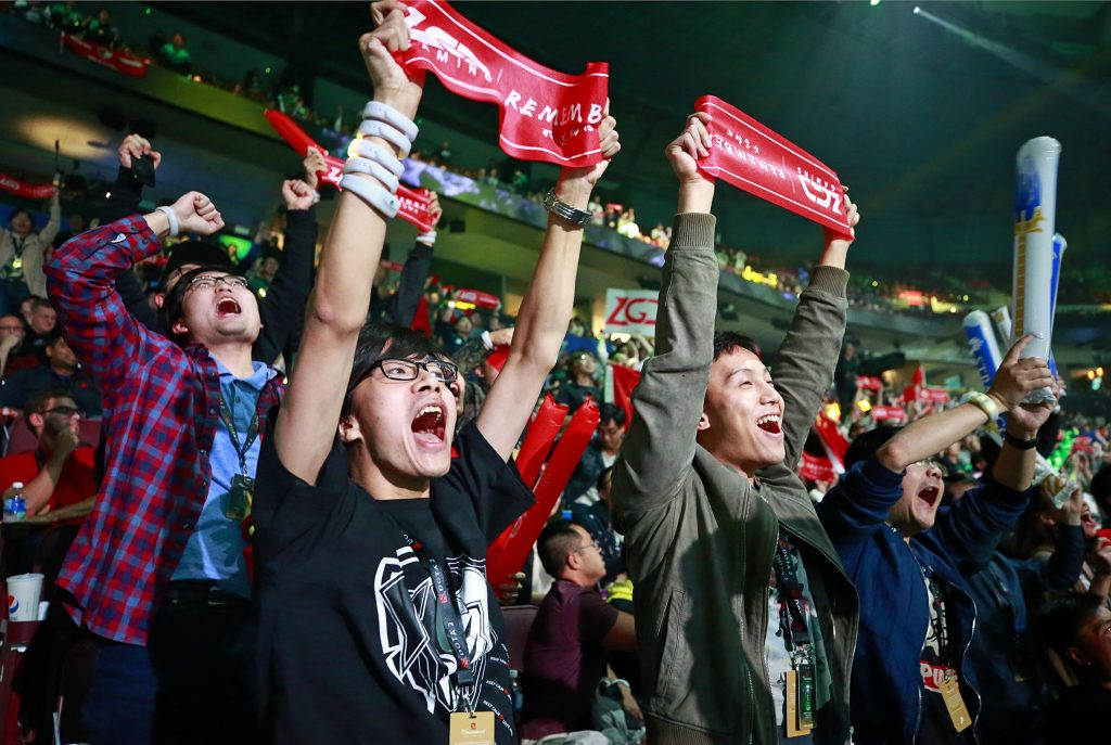 PSG.LGD fans react during the Dota 2 grand final match between PSG.LGD and OG (Getty Images)