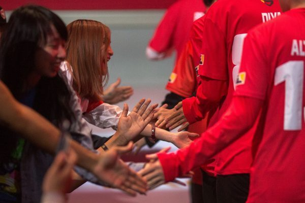 Fans reach out to Shanghai Dragons players as they prepare to play the New York Excelsior. (DAVID MCNEW/AFP/Getty Images)
