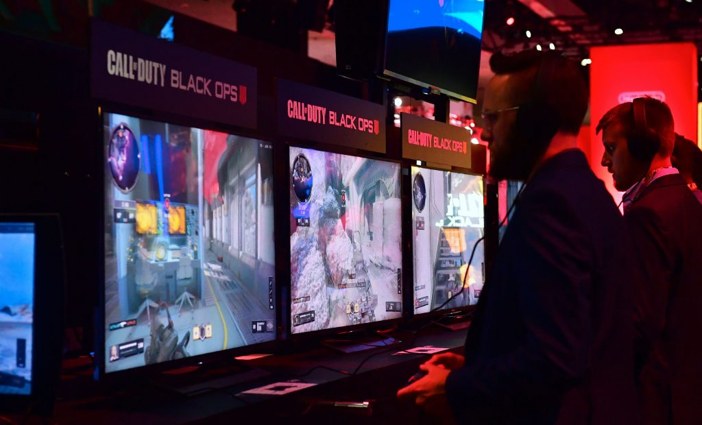Gamers play the game Call of Duty: Black Ops at E3 2018, (Photo courtesy of Getty Images)
