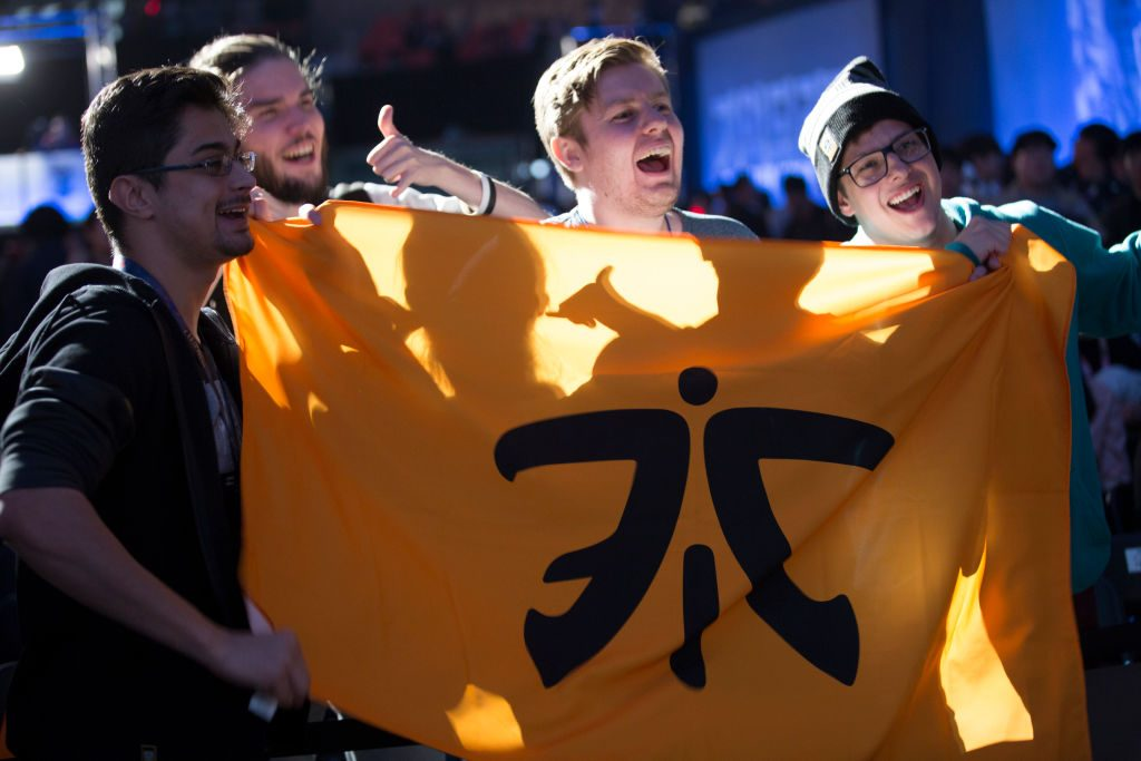 Fans showing off their Fnatic flag at semifinals of the League Of Legends Worlds Championship (Photo courtesy of Getty Images)