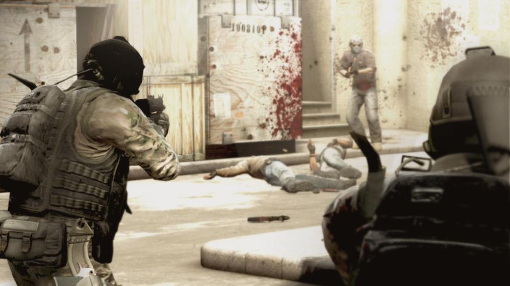 Counter-terrorists aim their guns at a terrorist during a game of CSGO.