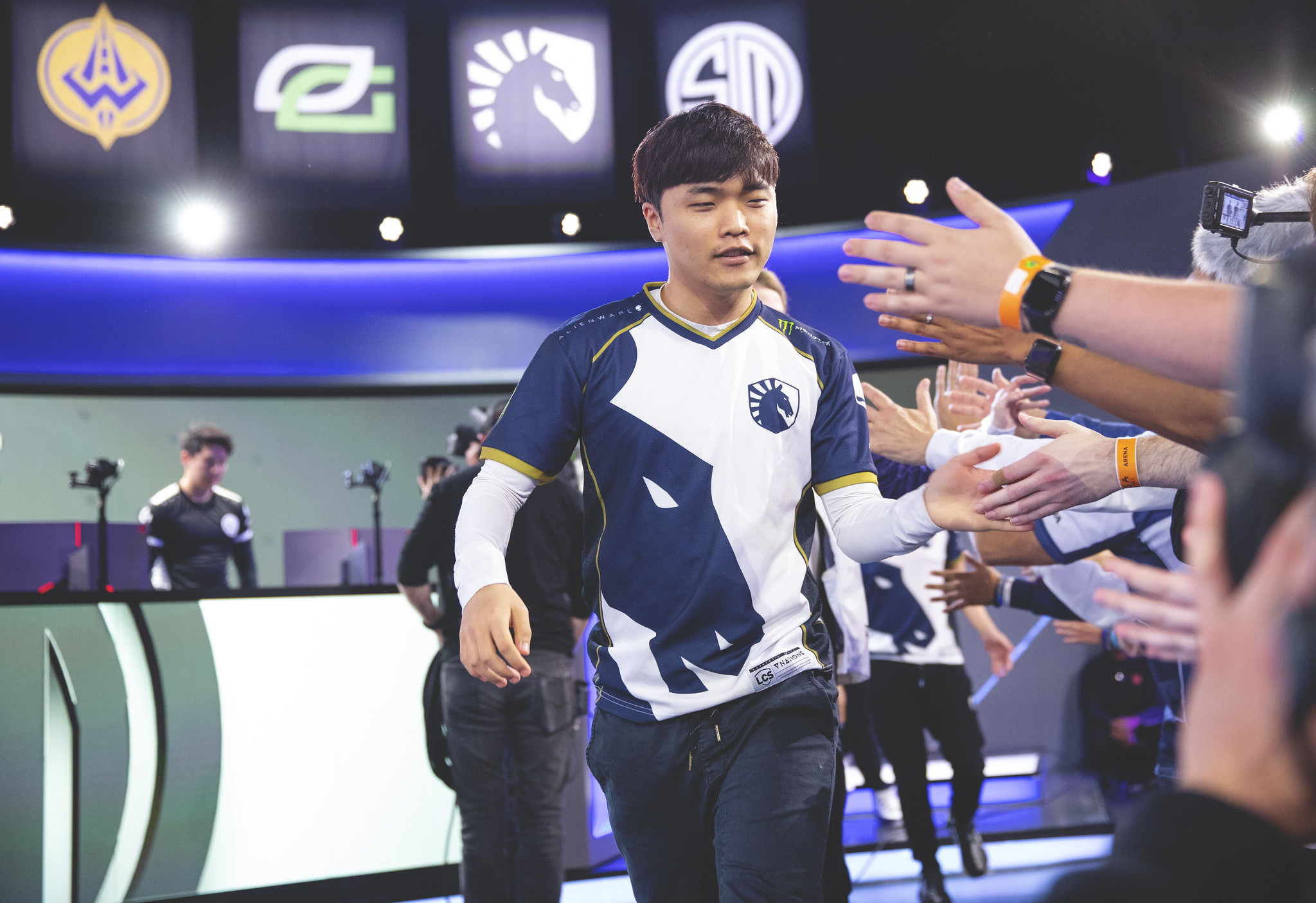 Impact high fives fans after a Team Liquid victory in the LCS
