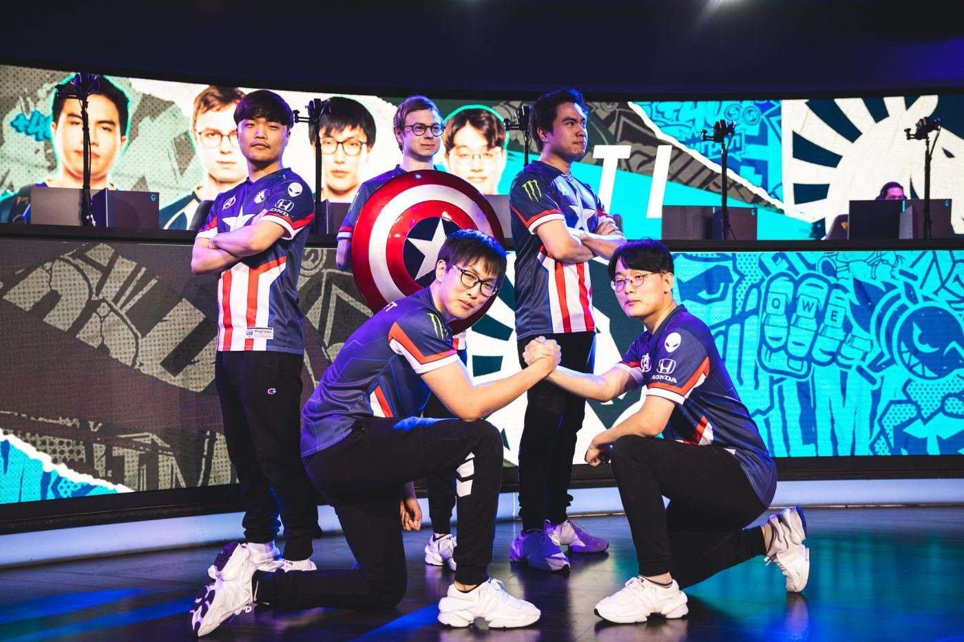 Team Liquid pose with Captain America shield