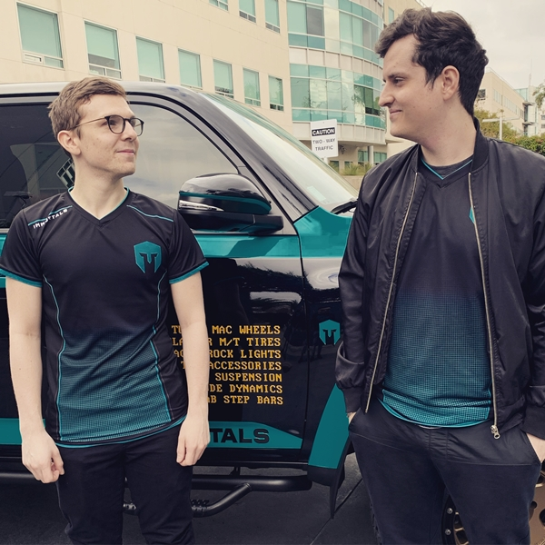 Immortals players standing in front of the IMT branded Toyota